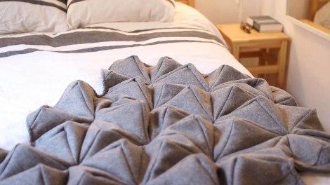 bloom blanket on bed