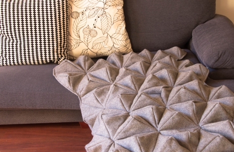 bloom blanket on sofa